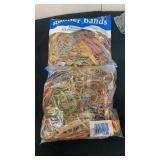 2 new bags of 1/2 pound of rubber bands
