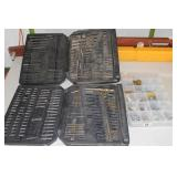 2 cases - drill bits, 1 case - bolts