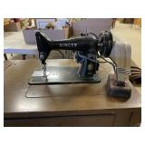 Singer sewing machine in cabinet Powers on