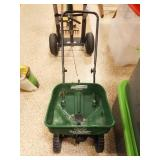 Yard Spreader and Bag of Fertilizer