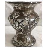 Hand blown glass vase with silver overlay