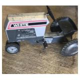 White toy peddle tractor