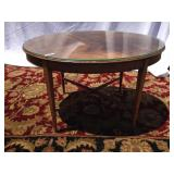Oval wood coffee table with glass top