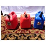 Trio of empty plastic gas cans