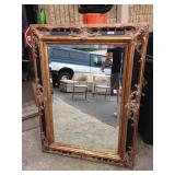 Large ornate mirror hand craved fram