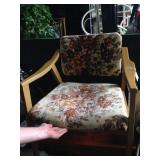Vintage wood armchair with floral cushion