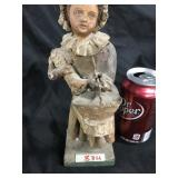 Antique girl with bonnet & basket figurine