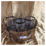 Drinking glasses in a basket holder