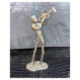 Vintage Bronze man playing the trumpet statue