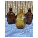 Vintage log cabin syrup bottles