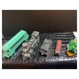 Set of four toy trains