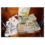 Lot of dish towels/ a tablecloth & pot holders