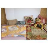 Assortment of decorative pillows/ quilt/ blanket/