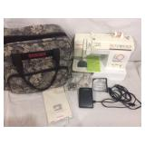 Singer sewing machine with carrying case and