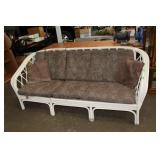 Wicker couch with cushions