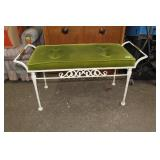 Heavy metal framed bench with upholstered seat