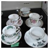 5 tea cups and saucers
