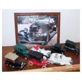 assorted small vehicles and framed car picture