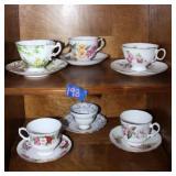 6 assorted tea cups & saucers