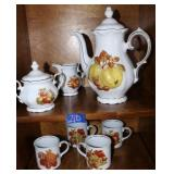 Coffee set with cream, sugar and mugs