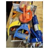 LOT OF CAULKING GUNS, SUCTION CUPS, HAND SAWS,