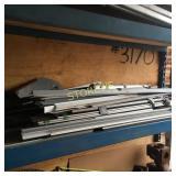 Shelf of Alumin Bars, Etc.