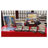 11 - MIXED LOT OF VHS & DVDS & TAPES