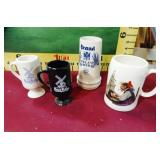 392 - 4 COLLECTIBLE COFFEE MUGS