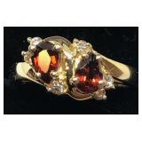 H105 14KT YELLOW GOLD GARNET AND DIAMOND RING