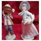 11 - BOY W/LAMB & GIRL W/FLOWERS FIGURINES