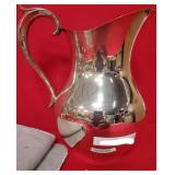 63 - STERLING SILVER WATER PITCHER