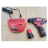 809 - MILWAUKEE PORTABLE DRILL W/CHARGER