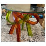 MULTI-COLORED ROUND TABLE - NEEDS TO BE REPAIR