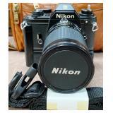 85 - NIKON CAMERA W/ BROWN LEATHER CASE - SEE PICS