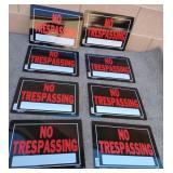 850 - LOT OF 8 NO TRESPASSING SIGNS