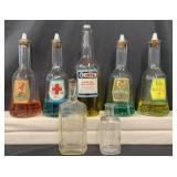 Lot of 7 Glass Barber Bottles