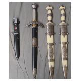 Four Military Daggers. Replicas.