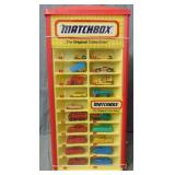 Matchbox Counter Display Near Full of Cars