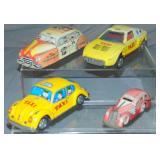4 Vintage Tin Taxi Toys