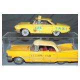 2 Japanese Tin Taxis