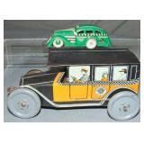2 Vintage Tin Taxi Toys