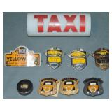 Assorted Taxi Badges and Light