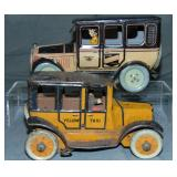 2 Early Tin Taxis