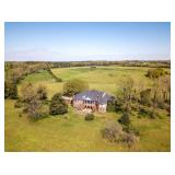 228 +/- Acres with a 9300 +/- sq. ft home. Property will be offered in multiple tracts.