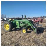 John Deere Tractor with Front Loader Hay Forks