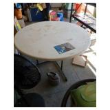 "60"" round fold in half  table"