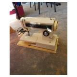 Kenmore ultra stitch 10 sewing machine with case.