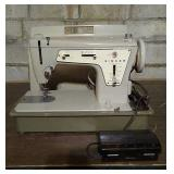 Singer brand sewing machine model 237. Includes