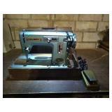 Premier brand deluxe model 105 sewing machine.