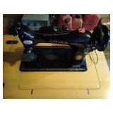 Singer brand sewing machine with table. Unit